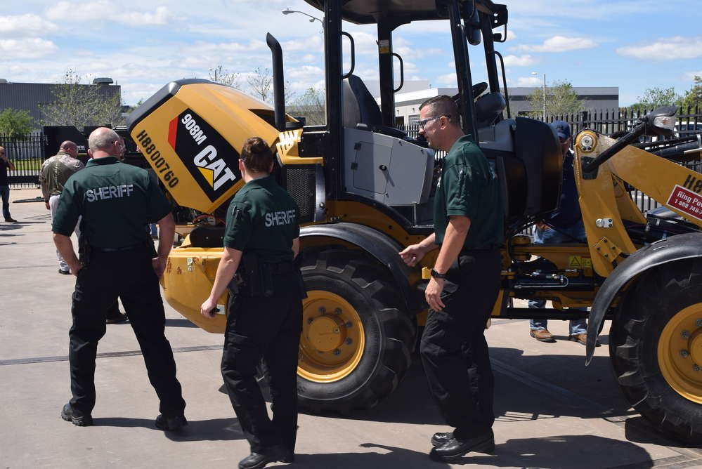 These sheriff deputies get an up-close look at this Cat 908M wheel loader.