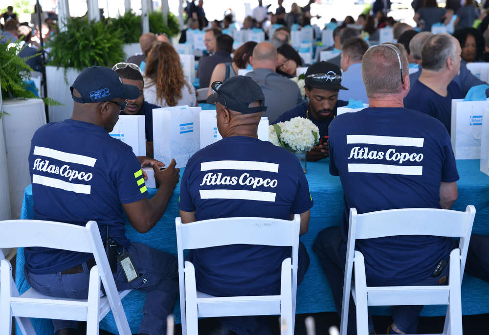 Atlas Copco employees gather for lunch and speeches during the grand opening of the Atlas Copco facility in Rock Hill, South Carolina, Wednesday, May 17, 2017. The plant employs more than 300 and serves as the production and assembly facility for the global company's North American Construction Technique division. The facility produces air compressors, generators and other equipment.