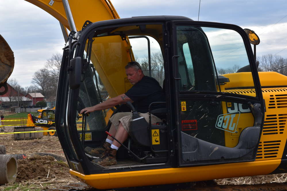Darren Irvine, heavy equipment operator of Pennsbury School District, tries out this JCB excavator.