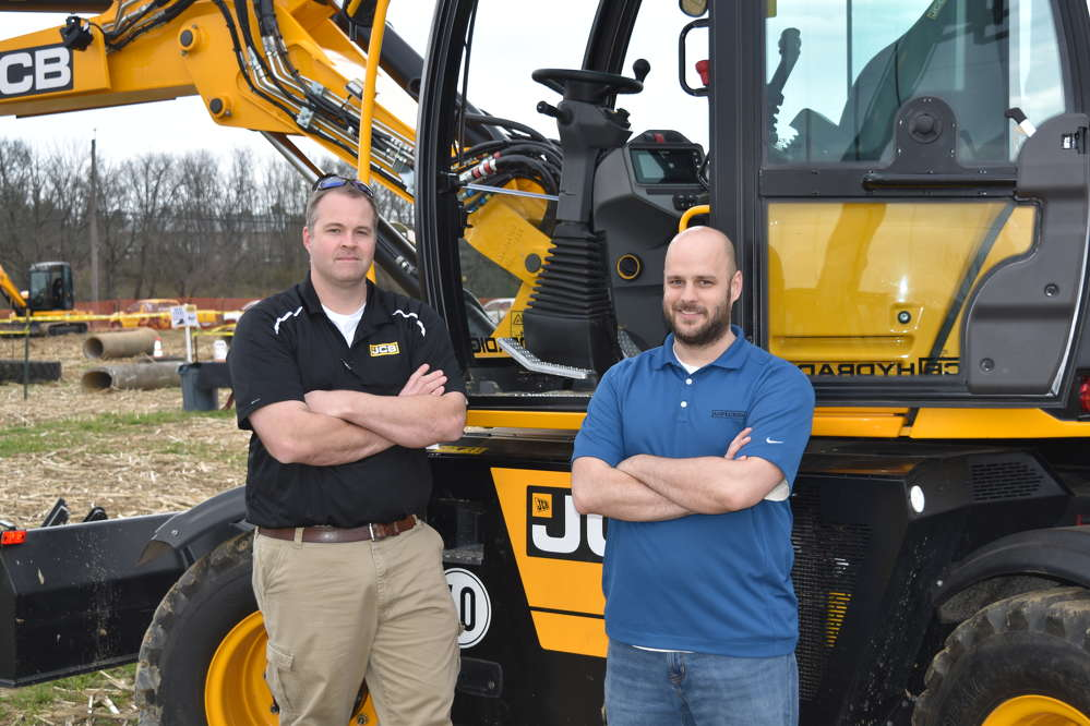 David Pendleton (L), regional business manager of JCB, and Paul Oliver, equipment advisor of Asplundh, stand in front of the new JCB Hydradig, which debuted at ConExpo this past March.