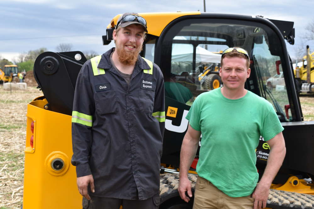Chris Bachman (L), Earthborne technician, and Chris Zeek, owner of Christopher Zeek Landscape Design and Construction, talk JCB equipment during the Demo Day.