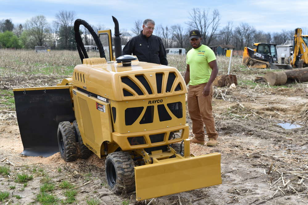 Mike Utterback (L), regional manager of Rayco, provides a product review to Mikell Wheeler, general laborer of Van Dine Construction LLC, Macungie, Pa