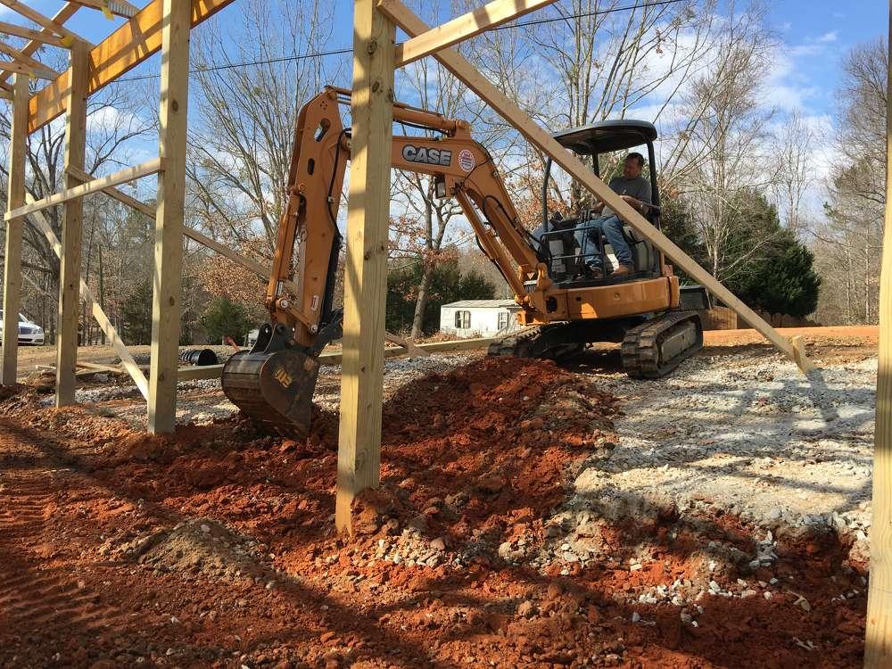 Dan Fehr operates his Case CX36B mini-excavator.