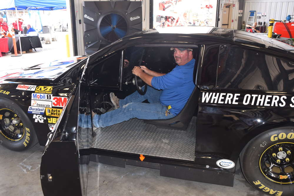 Barry Clawson of South West Construction Services enjoys the NASCAR simulator experience that was brought in for the event.