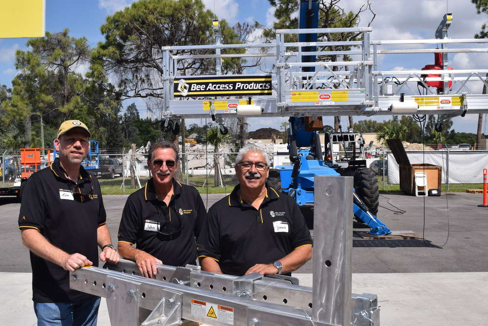 (L-R): Tom Dejong, John Belmonte and Bernie Duque, all of Bee Access Products, speak with attendees about suspended scaffolding products.