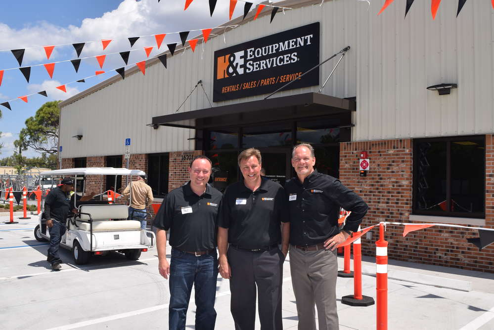 (L-R): Paul Stephen, vice president of marketing; Phil  Zachman, branch manager, Fort Myers, Fla.; and Toby Hawkins, all of H&E Equipment Services, were all very excited about the grand opening and visiting with their customers.
