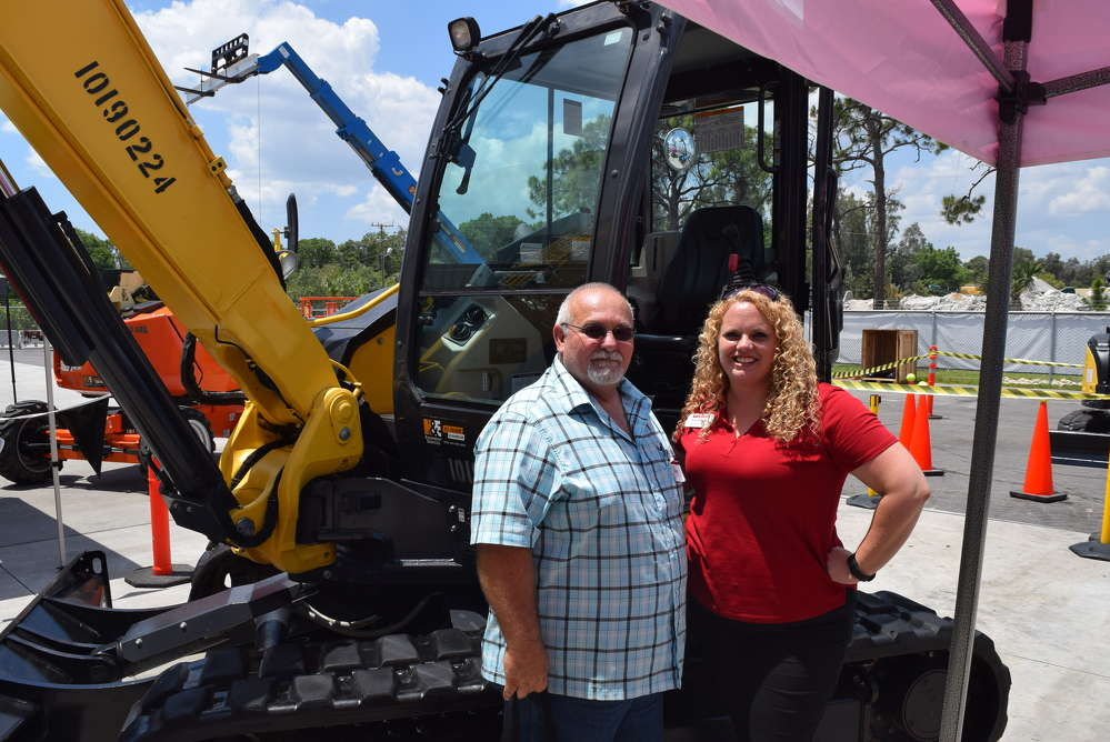 Ron Loweke of the city of Cape Coral and Jennifer Garrett of Yanmar go over the features of this Yanmar Vio80-1A  mini-excavator.