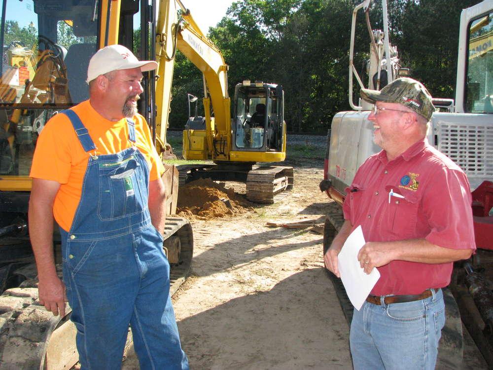 Dan Lumpkin (L), Diamond Equipment Repair, Rockmart, Ga., and Thomas Ray, T & C Earthmovers, Villa Rica, Ga., share a laugh at the auction.