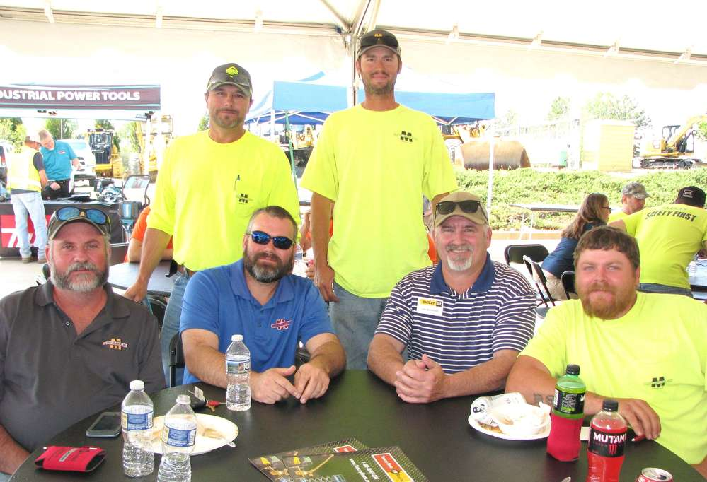 A big group from McCoy Grading, Greenville, Ga., had lunch with their Yancey representative, Lee Benefield, (second from R), including (L-R, sitting) Brad Brooks, Dwayne Davis, Benefield, and Thomas Lasiter and (L-R, standing) Joe Burgans and Heath Knauer.