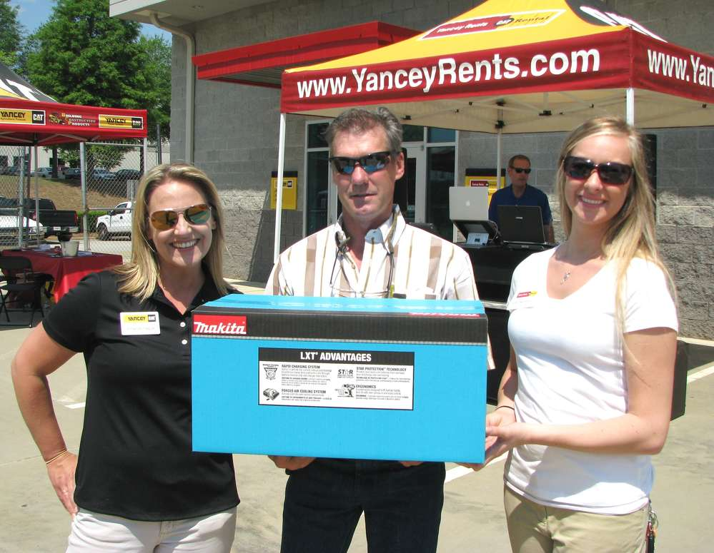 One of the prize winners of the day was Jeff Rowan (C) of Callaway Grading, Hampton, Ga., who left the event with a new Makita drill. Presenting the prize are Yancey's Amanda Hague (L) and Kristina Speach (R).