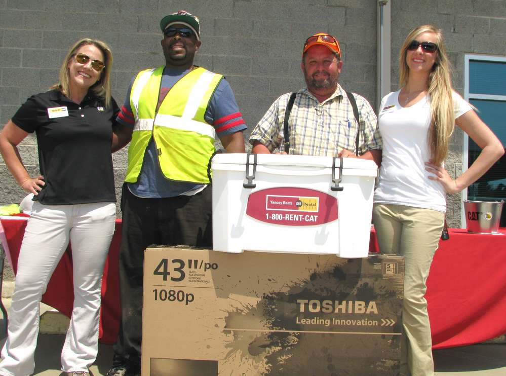 Yancey's Amanda Hague (L) and Kristina Speach (R) present the grand prizes of the day. Antonio Dubose (second from L) of McShane Construction, Mobile, Ala., won a 43-in. flat screen TV, and Alan Cawthon (second from R) of Alan Cawthon Grading, Jackson, Ga., won the Yancey-Yeti cooler.