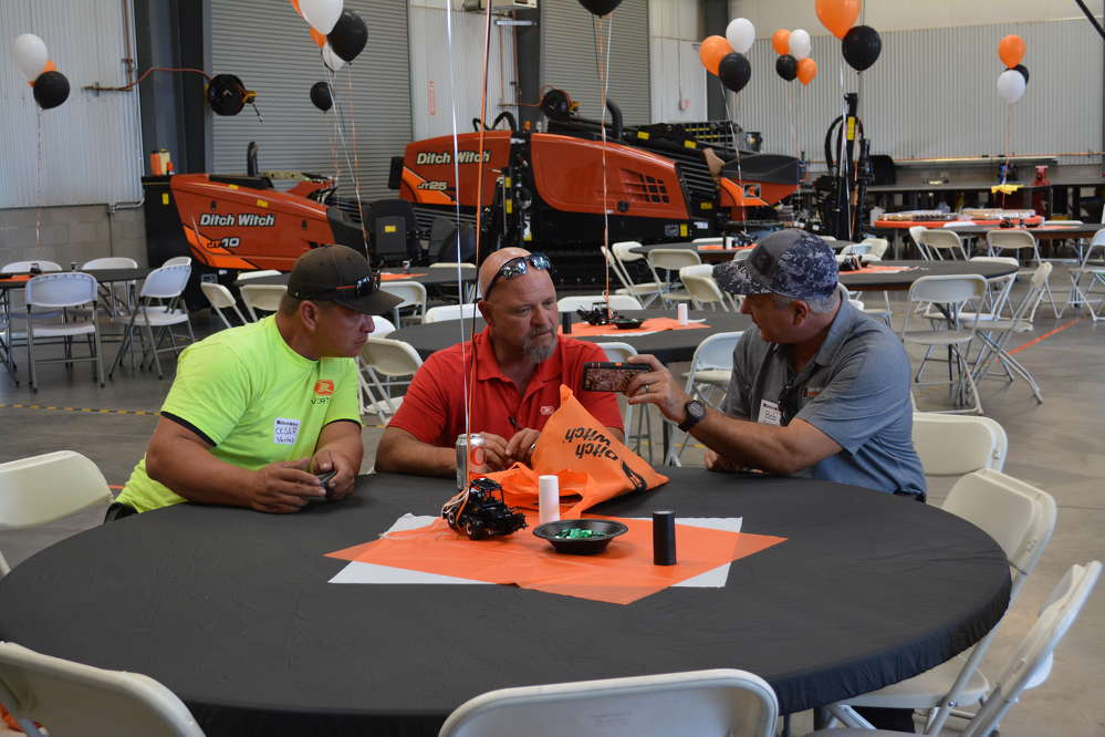 (L-R): Cesar Marcus and Sean O'Brien of Vertek chat with Ditch Witch of Arizona's Bob Mayer at the Customer Appreciation event held on May 12.