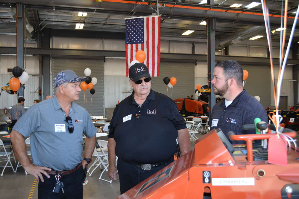 Bob Mayer (L) of Ditch Witch of Arizona and Cory Maker (R), Ditch Witch's regional sales manager of the southwest, answered questions about the new SK850 mini-skid steer from Blooming Desert Landscaping's K. Ross Oliver.