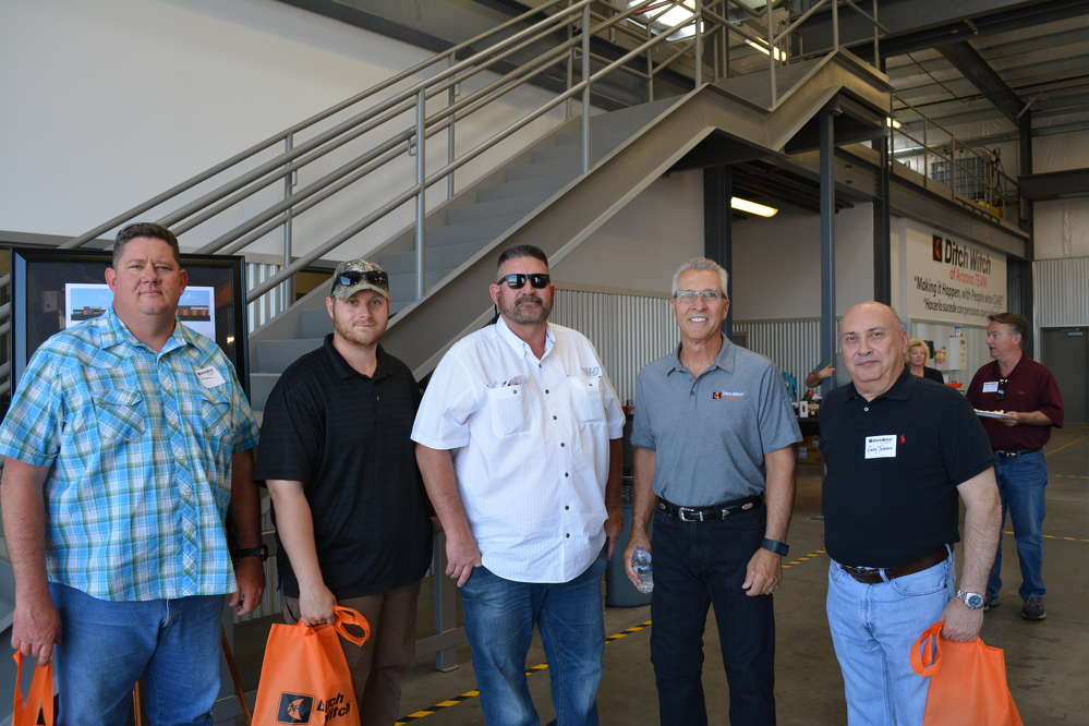 David Klingaman (second from R), owner of Ditch Witch of Arizona, welcomes (L-R) James Zimmerman, Andrew Lusk, John Lusk and Gary Tedesco, all of Kleven Construction.