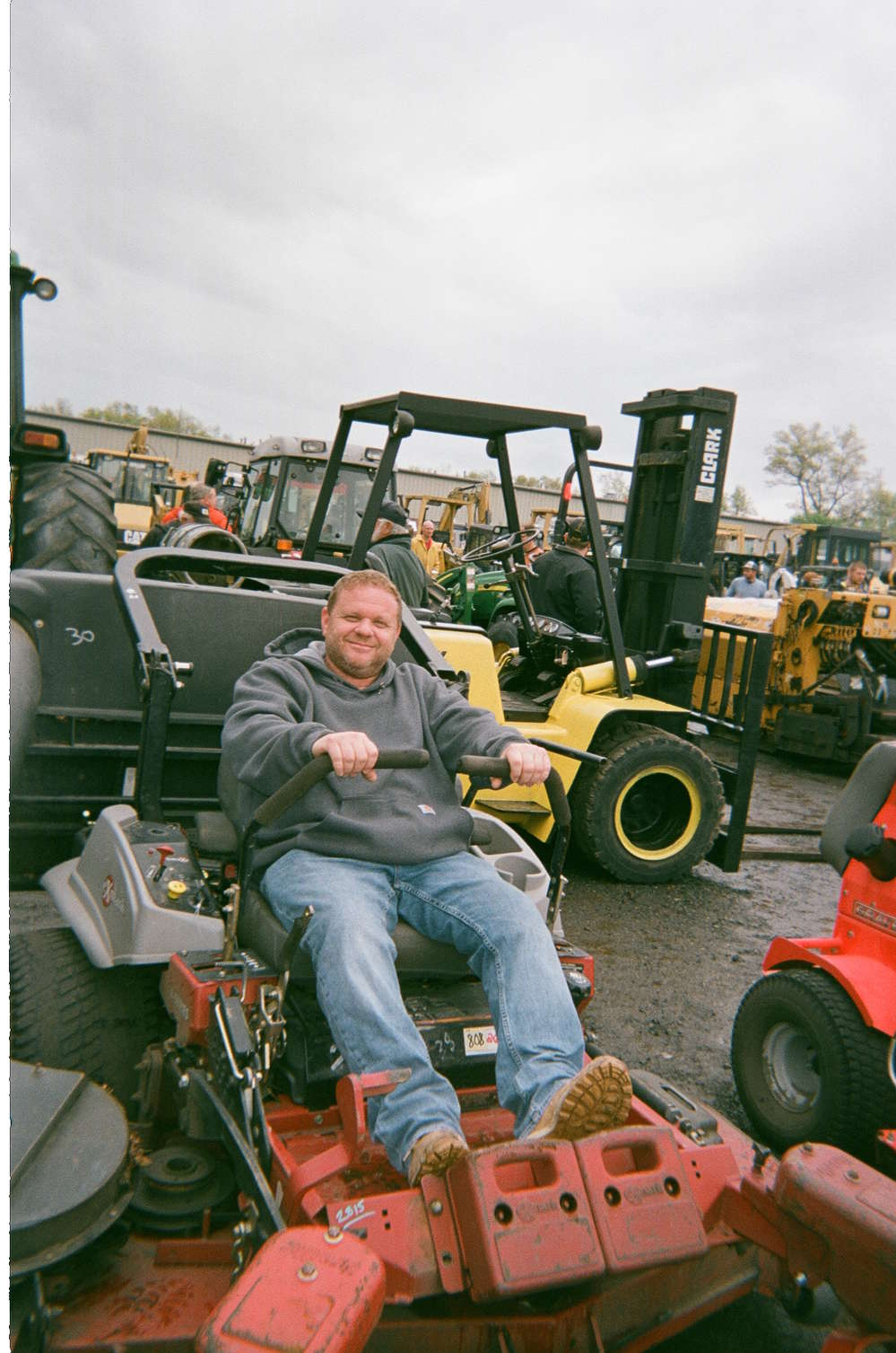 Dan Cusack of DC Rentals of Branford, Conn., tries out a lawn mower.