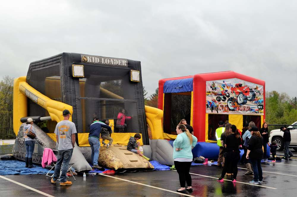 The dreary day didn't stop the children from enjoying the thrill of the bounce houses.