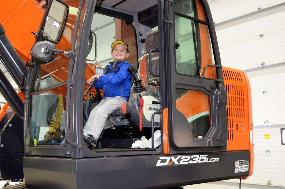 This little guy spent the entire afternoon checking out every piece of equipment on display. He was in construction equipment heaven.