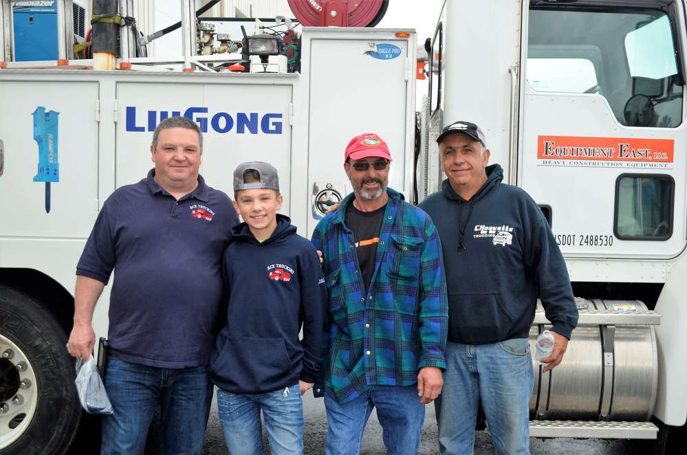 "(L-R) are Shawn Ventura, owner of ACE Trucking in Exeter, N.H.; Jacob Ventura, Shawn's son, of ACE Trucking; ""Silky""; and Norman Choquette of Choquette Trucking in Salisbury, Mass."