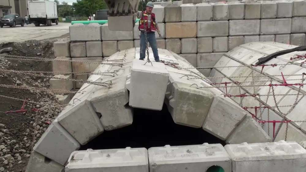 Interlocking blocks are assembled to create tunnels and archways without mortar.