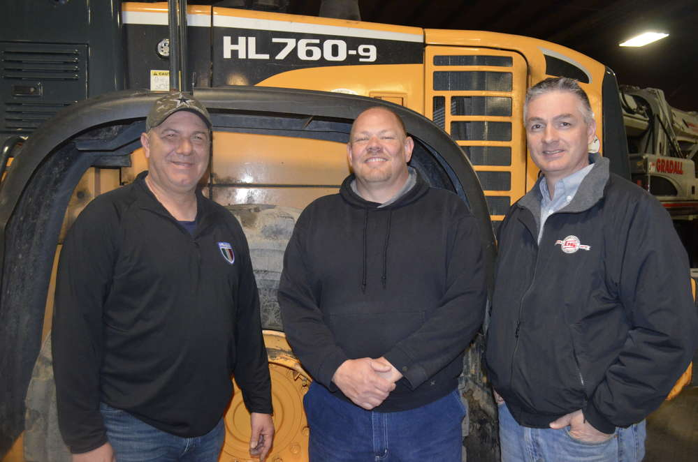 (L-R) are Chris Klein, Genesee County Highway Department fleet maintenance supervisor; Phil Marcello, Genesee County Highway Department heavy equipment operator; and Greg Newell, president of George & Swede Sales & Service.