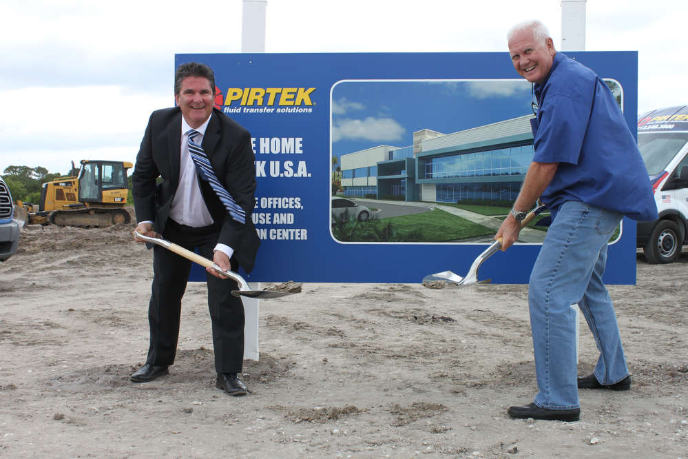 Glenn Duncan (L), chief executive officer of PIRTEK USA, and Rockledge Fla., Mayor Thomas J. Price, help get the project started.