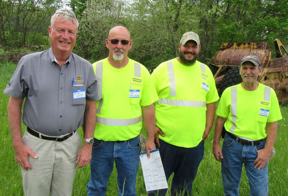 (L-R): Walsh Equipment's Mike Walsh catches up with Greenville Borough's Dale Linton, Jeff Savchuk and Cliff Brant at the open house event.