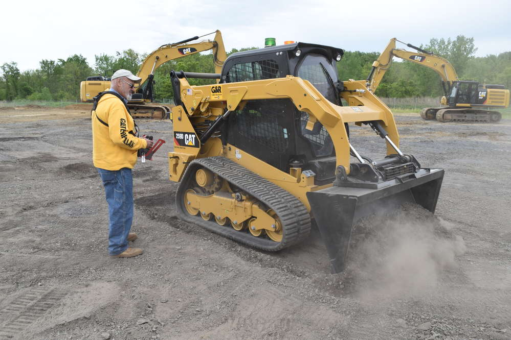 Ray Bowlin, owner of Ray Bowlin & Son Excavating Inc., Pennsburg, Pa., remotely operates a Caterpillar 259D skid steer during the Ransome CAT One Day Sale