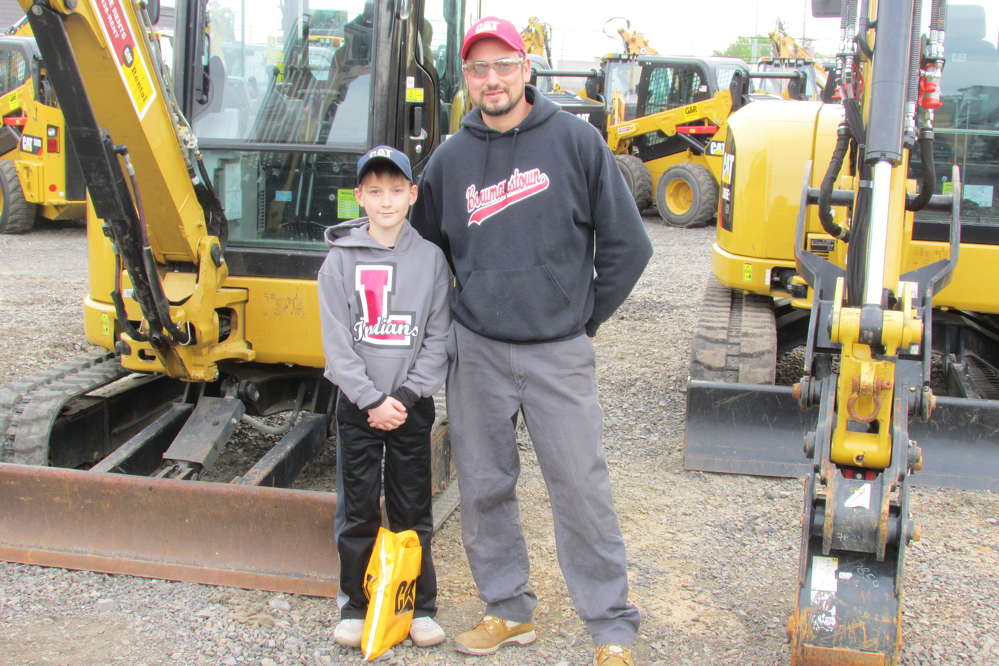 Charles Hartman of Hartman Land Care, Lehighton, Pa., and his son, Zander, are thinking about adding a Cat mini-excavator to their fleet.