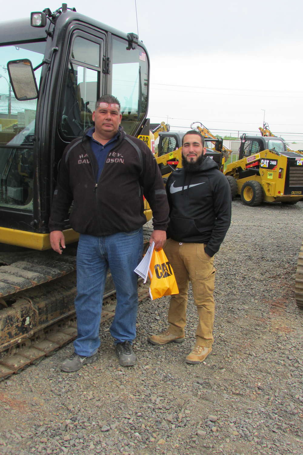 John Talmo (L), owner/operator, and Warren McMilin, both of Eastcoast Excavating LLC, spent a lot of time at the One Day Sale looking for bargains.