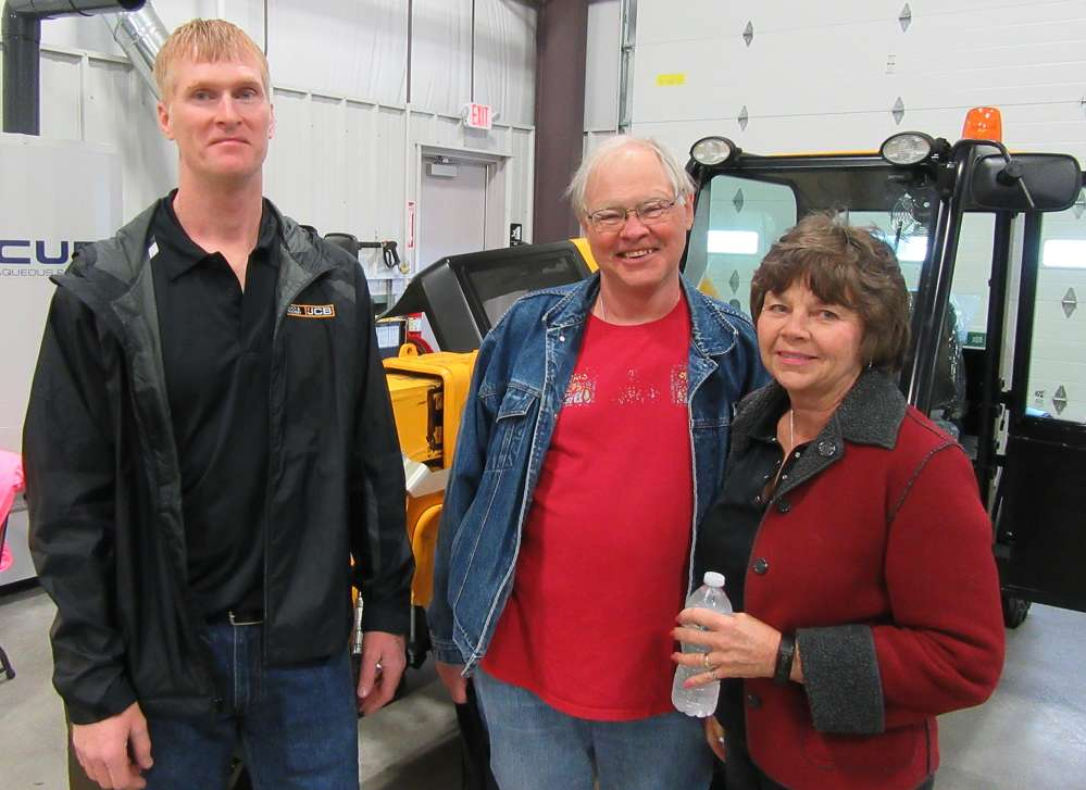 (L-R): Buck & Knobby's Rob Crowell welcomes Mike and Susie Clemmer, both of Riverside Retreat LLC, to the grand opening.
