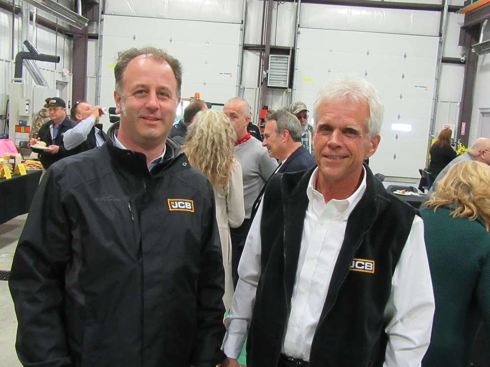 Jim Blower (L), JCB regional business manager, congratulates Gerry Maibach, Buck & Knobby equipment business manager, on the opening of the new facility.