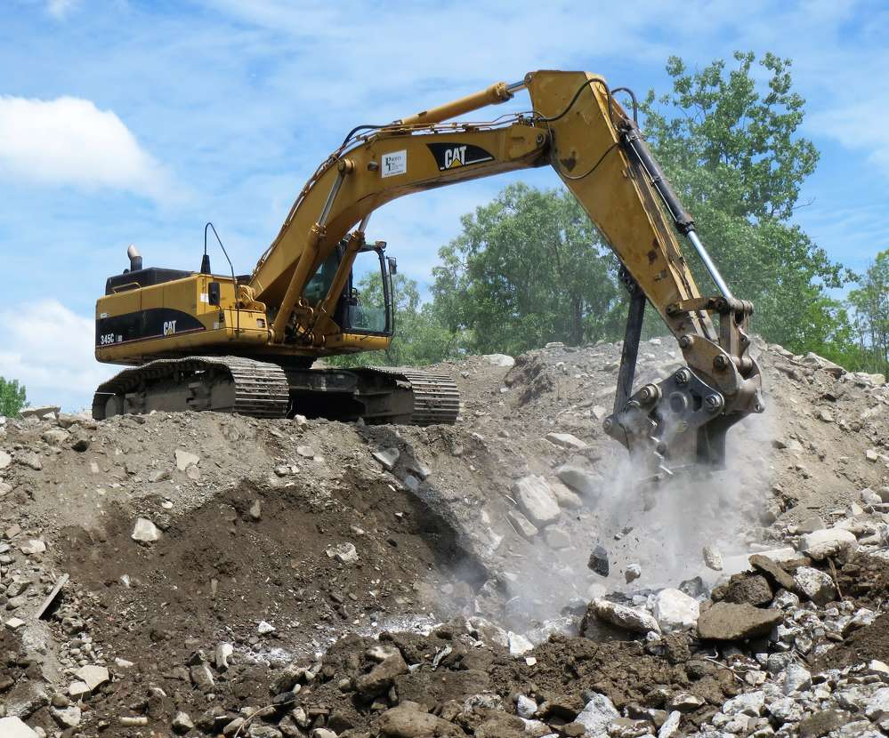 Brad Pelella of Profex channels the power of the Strickland SCP80 Mechanical Concrete Pulverizer through a CAT 345C L Excavator at the firm's yard in Newburgh, N.Y.