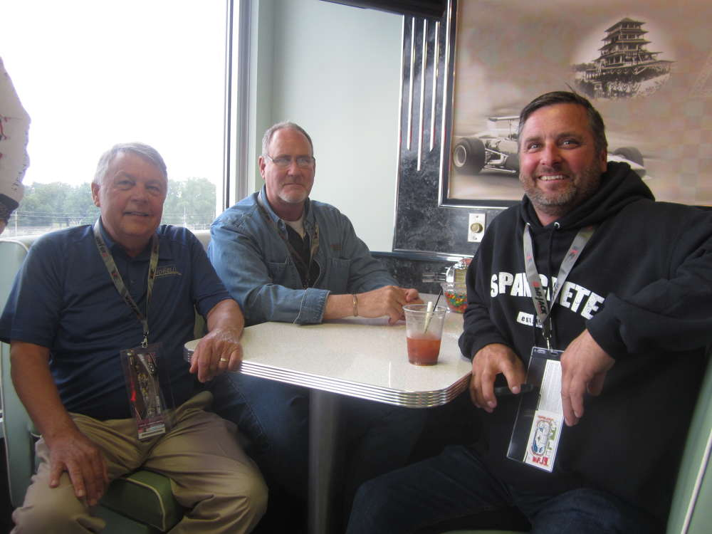 (L-R): Tom Ellis, president of Howell Tractor and Equipment and Tom Hall and Bobby McKenna, both of Area Erectors Inc., Rockford, Ill., spend some time relaxing before watching the qualifying.