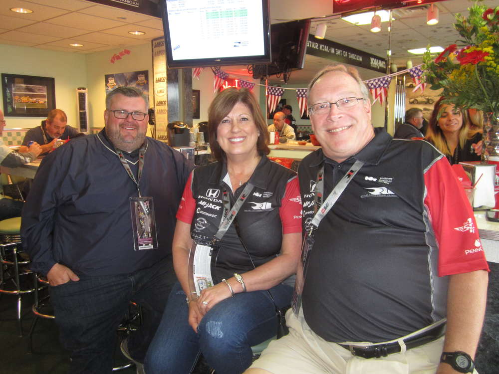 Enjoying the Armed Forces Pole Day at the Indianapolis Motor Speedway (L-R) are Mark Dehnert, Howell Tractor and Equipment, and Janet and Jeff Scott of Rogers Group.