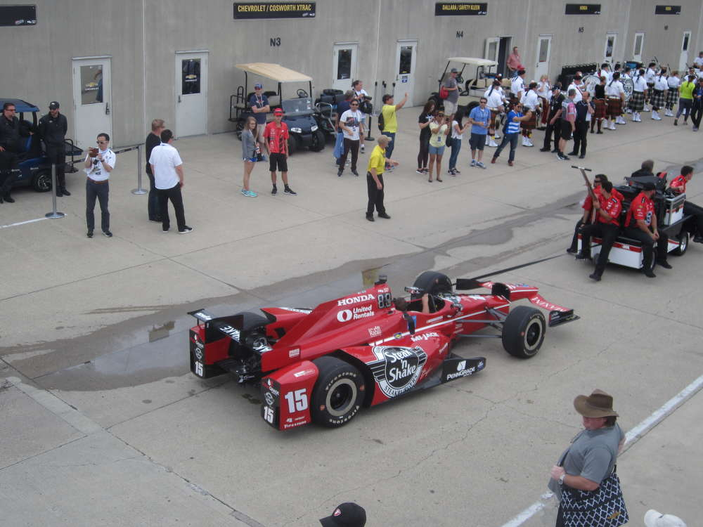 The #15 car driven by Graham Rahal goes back to the garage to get a final tune up before the official time trails begin.