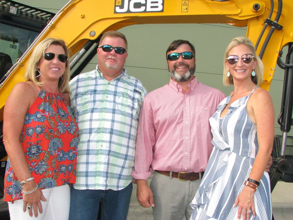 (L-R):?Gayle and Tommy Triplett of Triplett Land Clearing, Rincon, Ga., receive a warm welcome from Chris and Jessica Shea, Low Country JCB