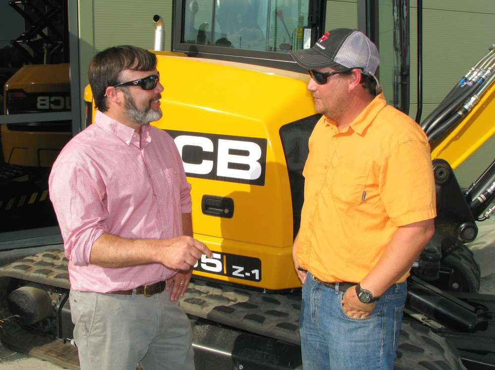 Chris Shea (L), Low Country JCB, and Mathew Woodrum of Mill Creek Construction, Statesboro, Ga., talk about the local construction industry.