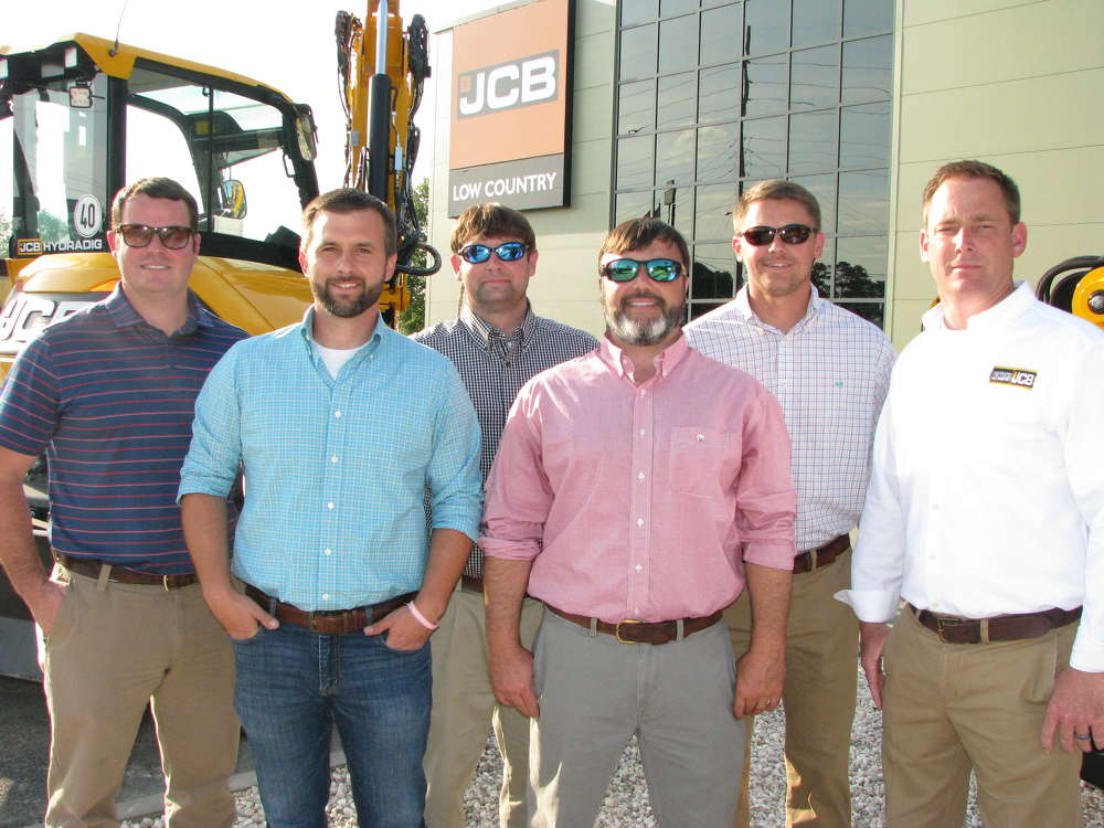(L-R): Tony Davis, Clint Holcombe, Jonathan Moore, Chris Shea, Matt Morris and Scott George, all of Low Country JCB, help attendees at the event.