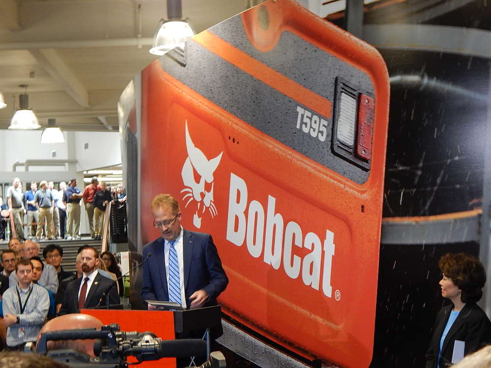 Rich Goldsbury, president and CEO Doosan/Bobcat NA/O, kicks off the grand opening event.