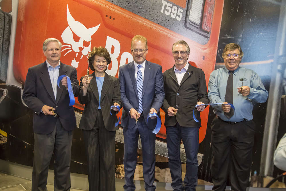 Several dignitaries and special guests delivered remarks during the grand opening ceremony. From left: U.S. Senator John Hoeven; Elaine L. Chao, U.S. Secretary of Transportation; Rich Goldsbury, president of Doosan Bobcat North America; North Dakota Governor Doug Burgum; and West Fargo Mayor Rich Mattern.
