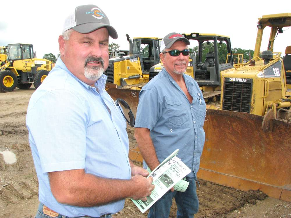 A couple of farmers out looking for a bargain on some older model dozers are Willie Taylor (L) of Buxton, Miss., and Ricky Wadley, Wadley Farms, Waynesboro, Miss.