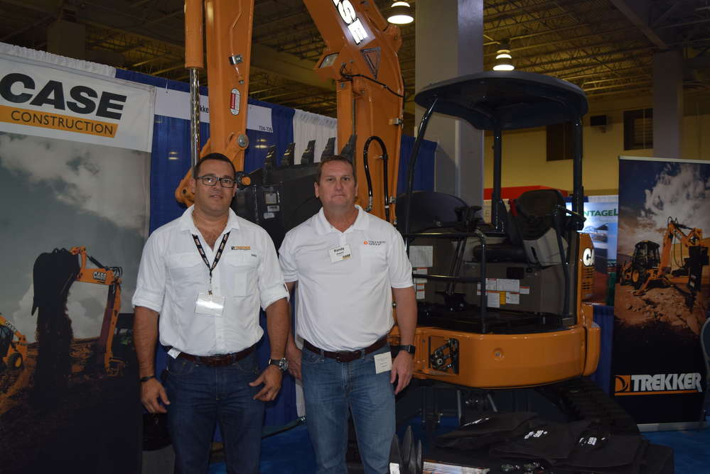 Jose Monque (L) and Randy Shearin, both of the Trekker Group, go over the features and benefits of the Case CX 36B mini-excavator.