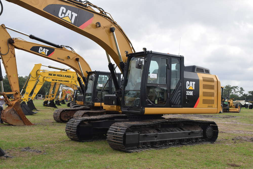A row of excavators were on the block at the Yoder Frey auction.