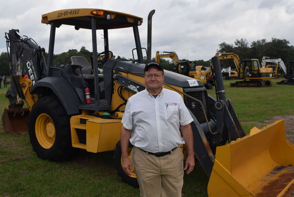 Craig Norton of Smart Business Credit shops the selection of equipment.