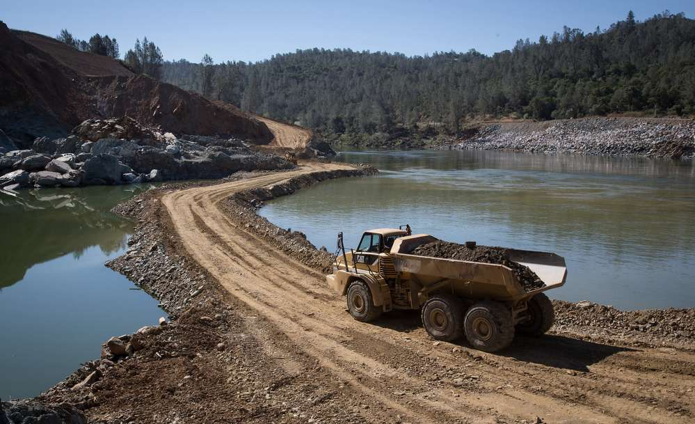 Officials described a Herculean operation that includes the construction of miles of access roads, two concrete plants and a maintenance facility for heavy equipment.