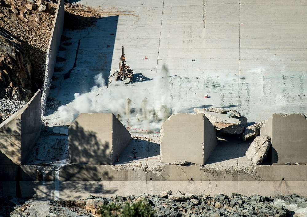 Huge swathes of the spillway's lower portion began washing away in February.