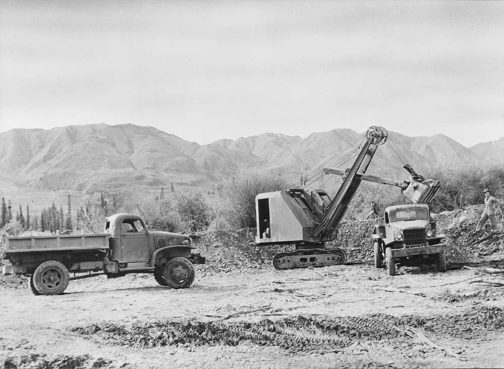Trucks load up at gravel dump. (Library of Congress photo)