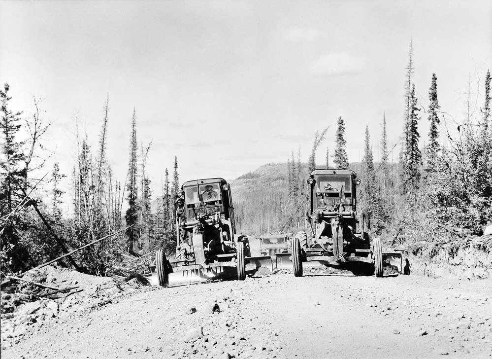 Two motorgraders level the roadbed. (Library of Congress photo)