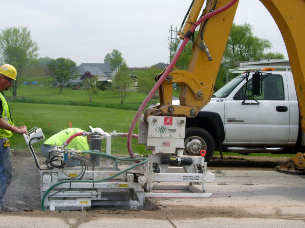 Minnich A3/A6 machine-mounted drills can be mounted to an excavator, backhoe or skid steer loader.