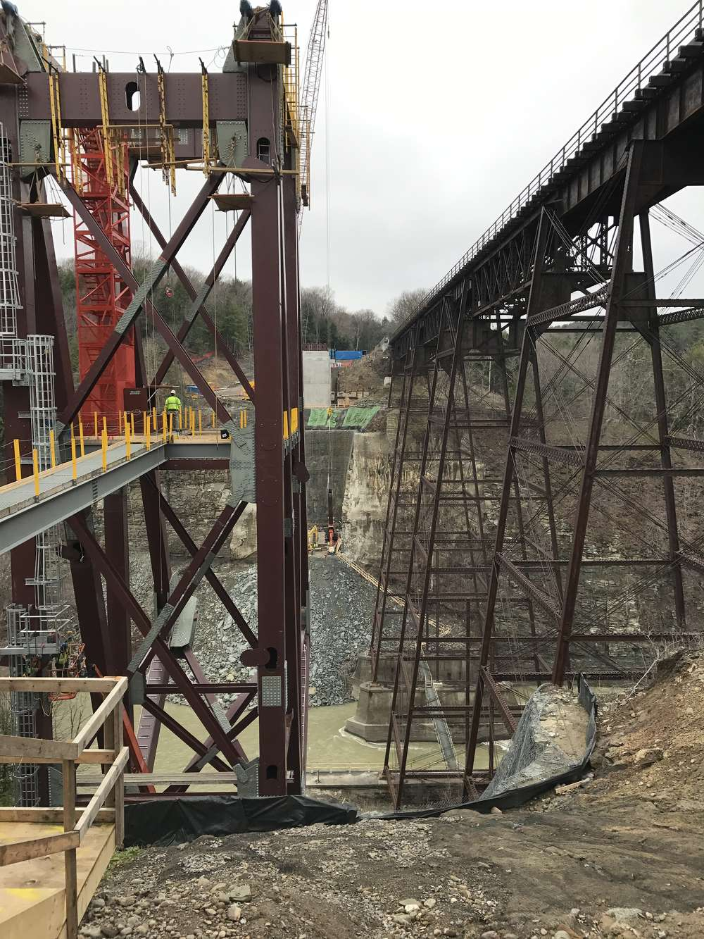 The existing structure, built in 1875, will remain open during construction of the new arch bridge and then be dismantled.